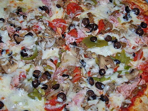 Pizza Suprema: Pepperoni, Italian Sausage, Mushrooms, Red Onions ...
